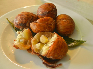 Steamed chestnuts as a snack with a glass of red wine